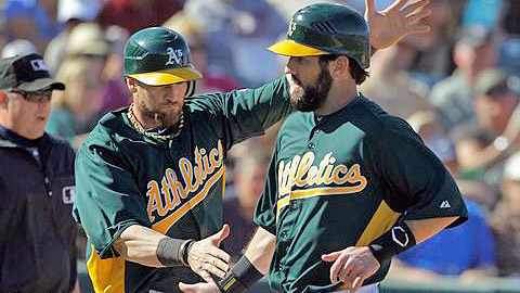 The A's Jason Pridie (right) will miss his first 50 games this season.